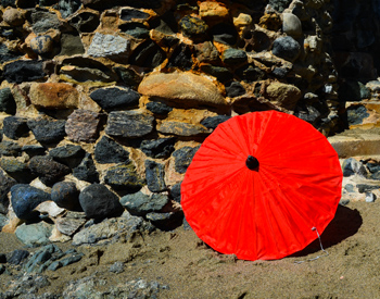 red parasol and stones small file